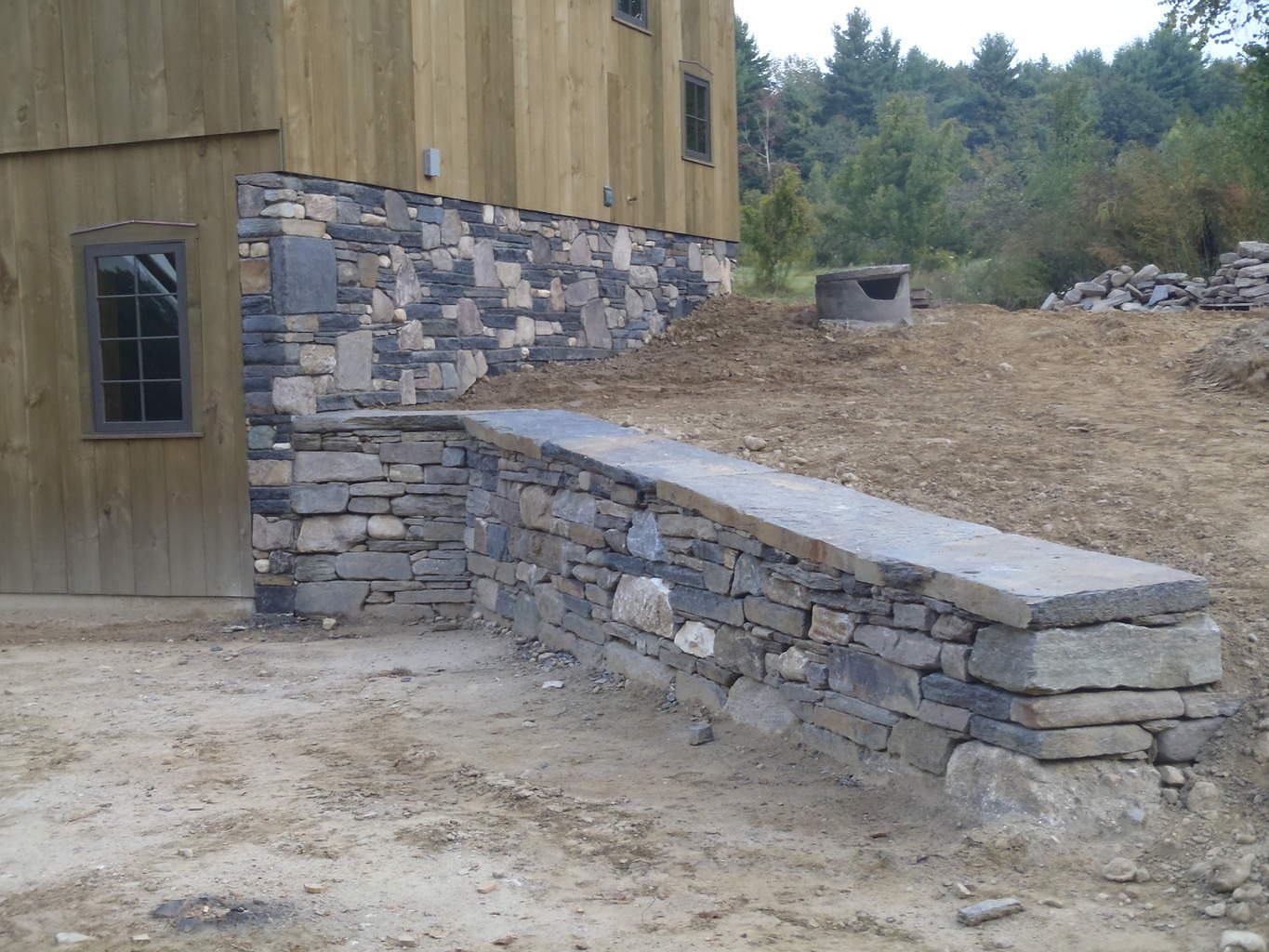 how to build a stone house foundation