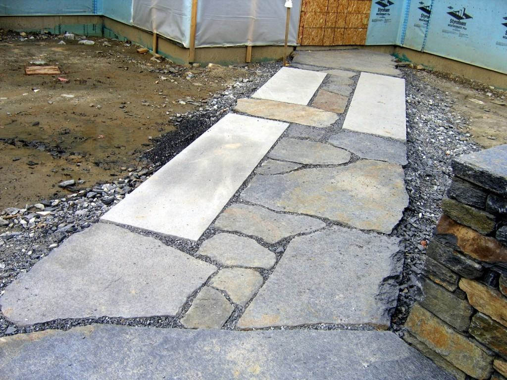 Stone walkway around pool house