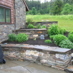 A  3 tiered stone wall planting bed