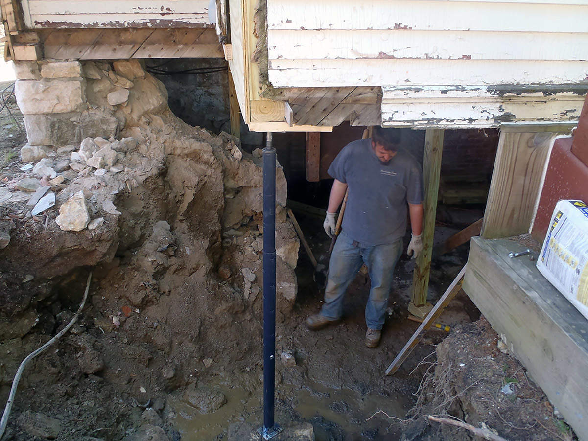 Removing the old wall and foundation